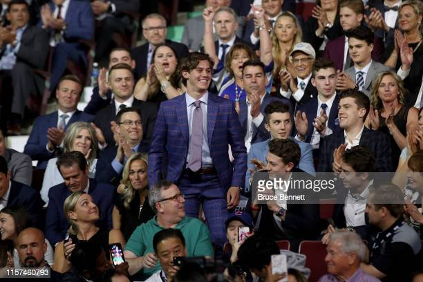 Jack Hughes smiles after being selected first overall by the New Jersey Devils during the first round of the 2019 NHL Draft at Rogers Arena on June...