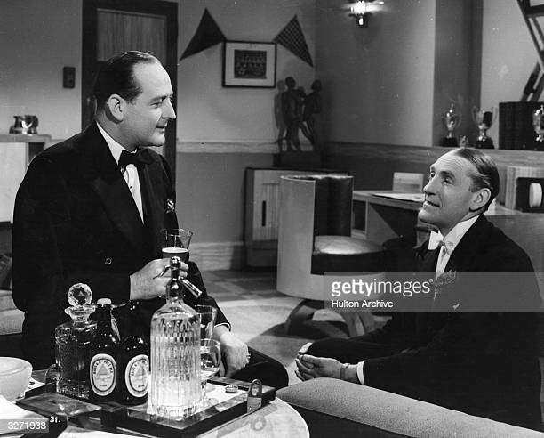 Jack Hulbert and Cecil Parker star in the spy film ' Under Your Hat' directed by Maurice Elvey for Republic/British Lion