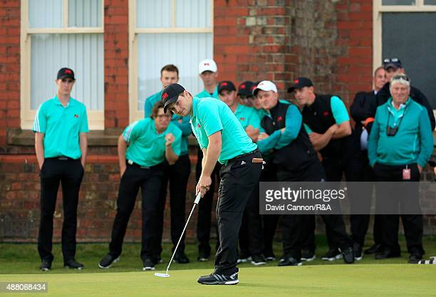 Jack Hume of Great Britain and Ireland putts on the 198th green in his match with Robby Shelton of the United States during the final afternoon...