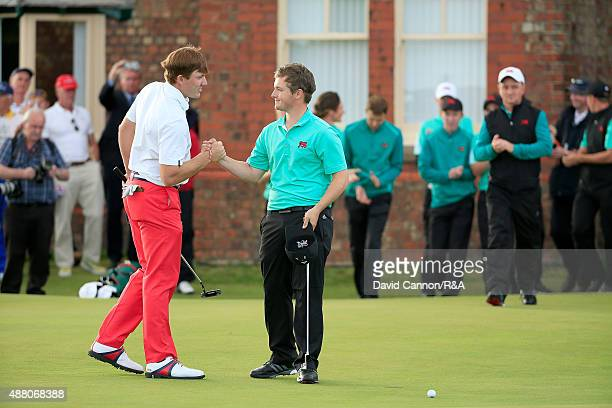 Jack Hume of Great Britain and Ireland shakes hands with Robby Shelton of the United States after they had halved their match on the18th green during...