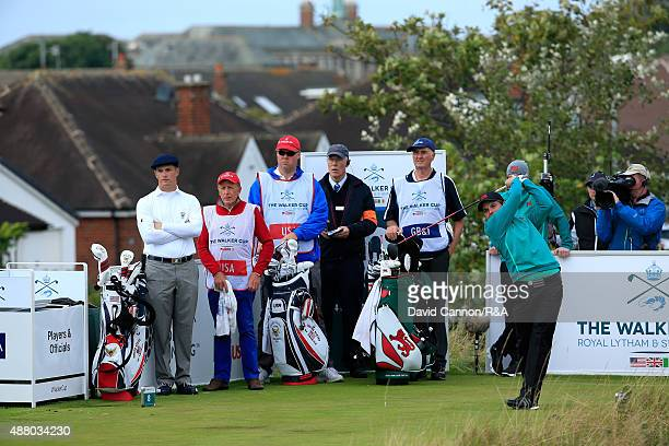 Jack Hume of the Great Britain and Ireland team plays his tee shot on the 8th hole in his match with Gavin Moynihan against Bryson DeChambeau and...