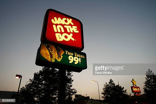 Jack In The Box and Carls Jr fastfood restaurant signs glow July 24 2008 on the Figueroa Street Corridor of South Los Angeles area of Los Angeles...