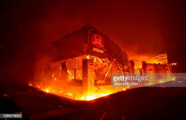 Jack In The Box fast food restaurant burns as the Camp fire tears through Paradise north of Sacramento California on November 08 2018 More than one...