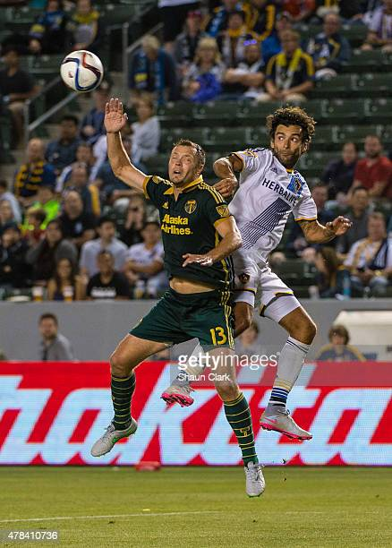 Jack Jewsbury of Portland Timbers and Baggio Husidic of Los Angeles Galaxy jump for a header during Los Angeles Galaxy's MLS match against Portland...