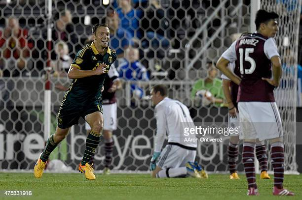 Jack Jewsbury of Portland Timbers reacts to scoring a 21 gamewinning goal in the 90th minute on Clint Irwin of Colorado Rapids during the second half...