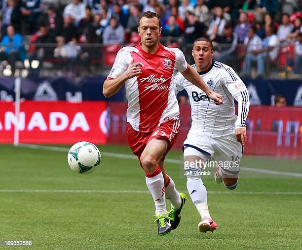 Jack Jewsbury of the Portland Timbers and Erik Hurtado of the Vancouver Whitecaps FC chase after the ball during their MLS game on May 18 2013 at BC...