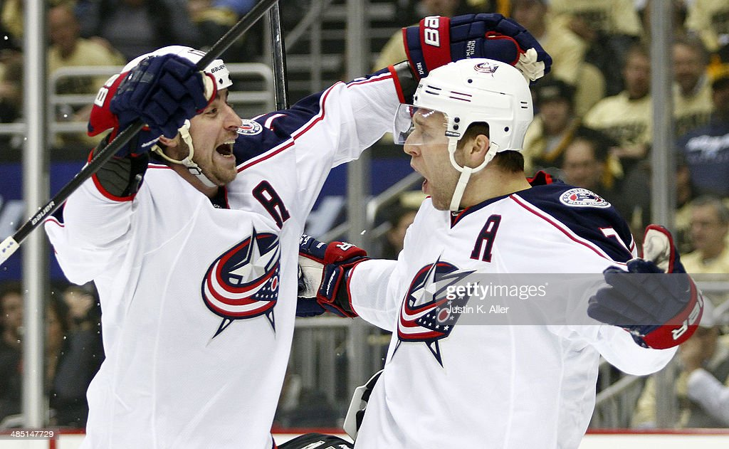 Jack Johnson #7 celebrates with Brandon Dubinsky #17 of the Columbus Blue Jackets against the Pittsburgh Penguins in Game One of the First Round of the 2014 NHL Stanley Cup Playoffs at Consol Energy Center on April 16, 2014 in Pittsburgh, Pennsylvania.