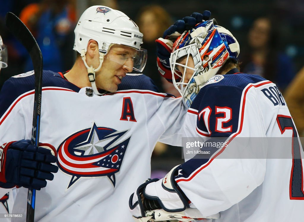 Jack Johnson #7 of the Columbus Blue Jackets congratulates Sergei Bobrovsky #72 on a 4-1 win against the New York Islanders at Barclays Center on February 13, 2018 in New York City.