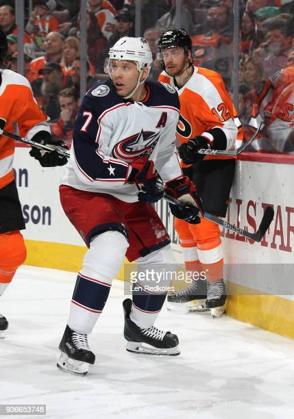 Jack Johnson of the Columbus Blue Jackets in action against Michael Raffl of the Philadelphia Flyers on March 15 2018 at the Wells Fargo Center in...