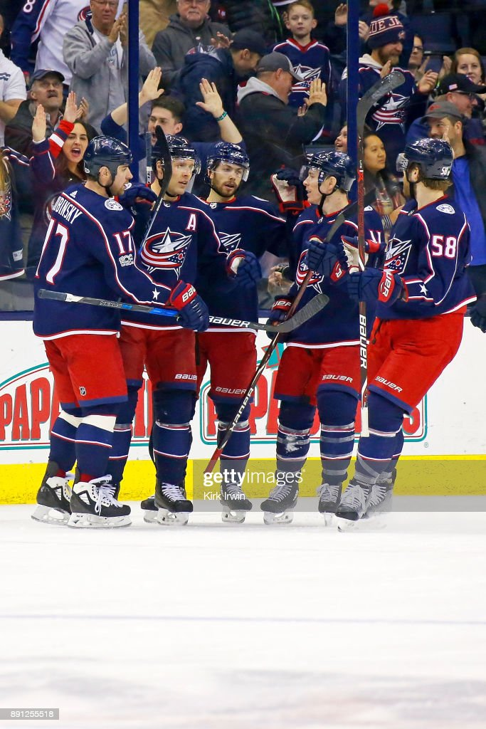Jack Johnson #7 of the Columbus Blue Jackets is congratulated by his teammates after scoring a goal during the third period of the game against the Edmonton Oilers on December 12, 2017 at Nationwide Arena in Columbus, Ohio. Edmonton defeated Columbus 7-2.