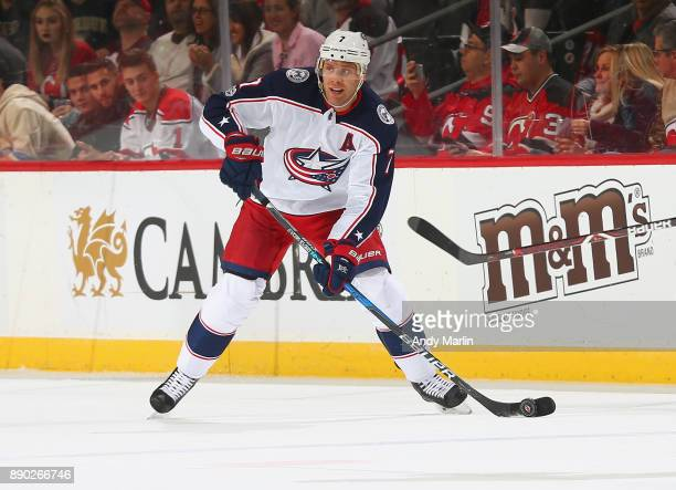 Jack Johnson of the Columbus Blue Jackets plays the puck during the game against the New Jersey Devils at Prudential Center on December 8 2017 in...