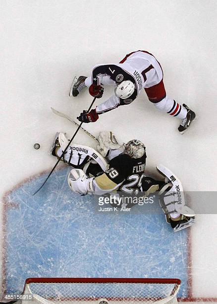 Jack Johnson of the Columbus Blue Jackets scores past MarcAndre Fleury of the Pittsburgh Penguins in the first period in Game One of the First Round...