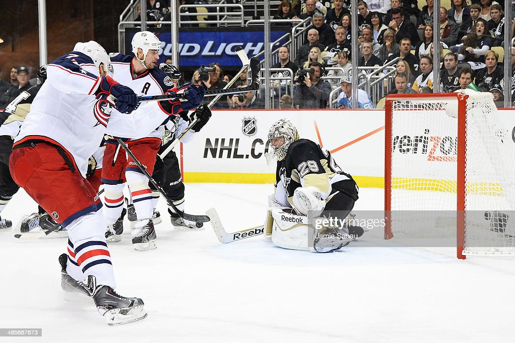 Jack Johnson #7 of the Columbus Blue Jackets scores the game-tying goal on goaltender Marc-Andre Fleury #29 of the Pittsburgh Penguins on a power play in the third period in Game Two of the First Round of the 2014 NHL Stanley Cup Playoffs on April 19, 2014 at CONSOL Energy Center in Pittsburgh, Pennsylvania.
