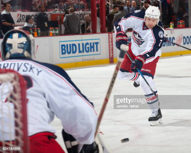 Jack Johnson of the Columbus Blue Jackets shoots the puck on goalie Sergei Bobrovsky during pregame warm ups before an NHL game against the Detroit...