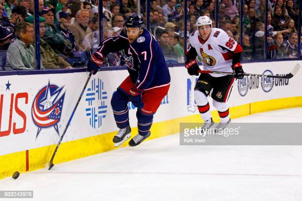 Jack Johnson of the Columbus Blue Jackets skates the puck away from Matt Duchene of the Ottawa Senators during the first period on March 17 2018 at...