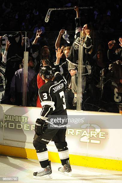Jack Johnson of the Los Angeles Kings gives his stick to a fan after defeating the Vancouver Canucks in Game Three of the Western Conference...