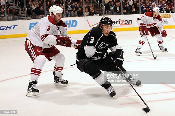 Jack Johnson of the Los Angeles Kings skates with the puck against Keith Yandle of the Phoenix Coyotes on April 8 2010 at Staples Center in Los...