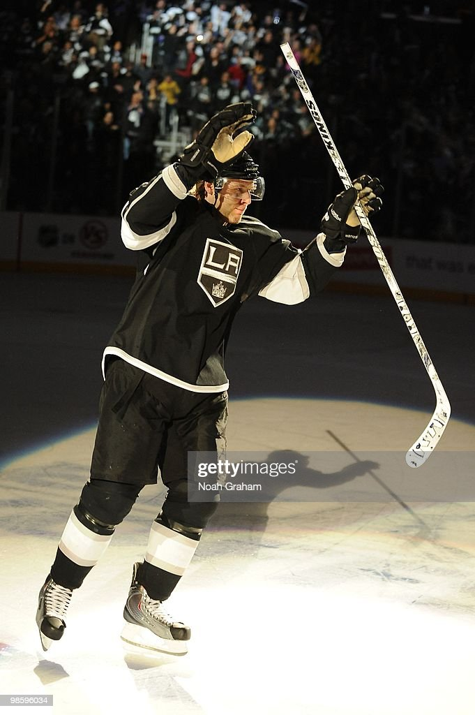 Jack Johnson #3 of the Los Angeles Kings waves to the crowd after defeating the Vancouver Canucks in Game Three of the Western Conference Quarterfinals during the 2010 NHL Stanley Cup Playoffs at Staples Center on April 19, 2010 in Los Angeles, California.