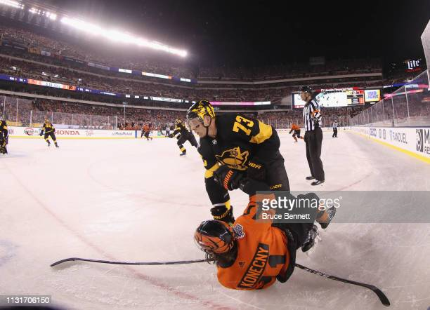 Jack Johnson of the Pittsburgh Penguins checks Travis Konecny of the Philadelphia Flyers during the second period during the 2019 Coors Light NHL...
