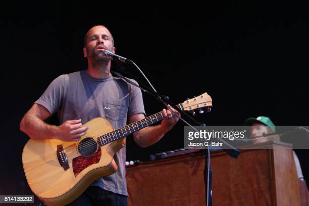 Jack Johnson plays the guitar with Zach Gill on the keys at Fiddler's Green Amphitheatre on July 13 2017 in Englewood Colorado