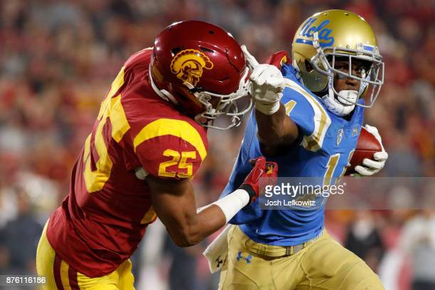 Jack Jones of the USC Trojans tackles Theo Howard of the UCLA Bruins during the NCAA college football game at the Los Angeles Memorial Coliseum on...