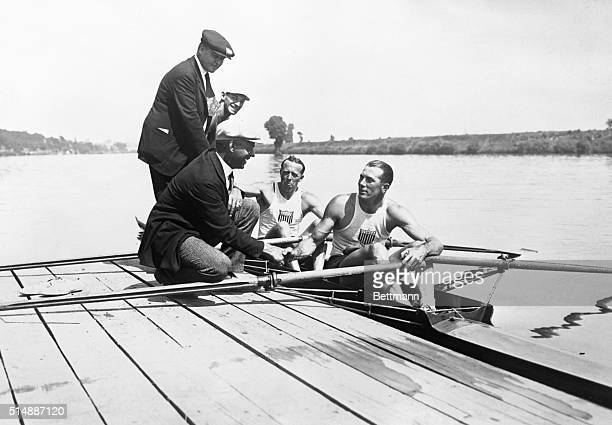 Jack Kelly and Paul Costello congratulated by Mr Daby of the American Rowing Association and Coach Muller after victory in the Olympic Double Sculls