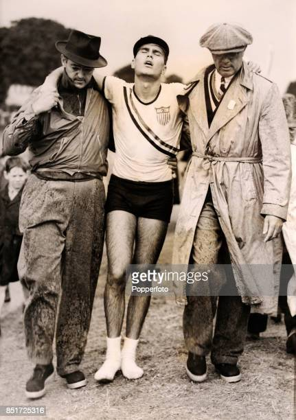 Jack Kelly of the USA is assisted by his father John Kelly and a coach after his defeat by Eduardo Risso of Uruguay the eventual silver medallist in...