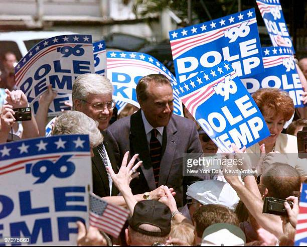 Jack Kemp and Bob Dole are greeted by supporters Sunday on their arrival at Embarcadero Marina Park behind the San Diego Convention Center. The...