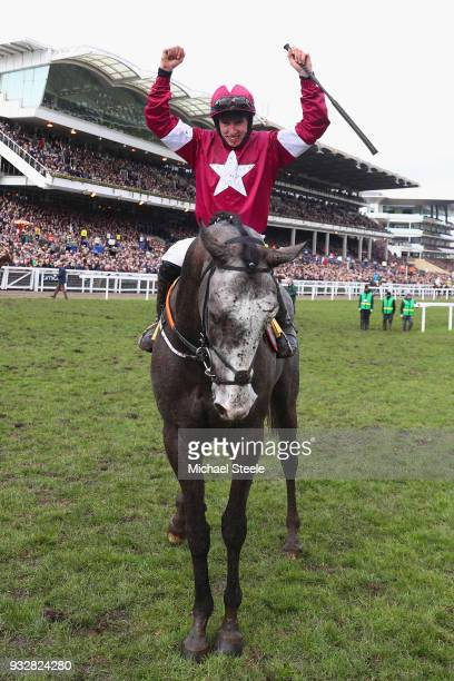 Jack Kennedy celebrates after he rides Farclas to victory in the JCB Triumph Hurdle at the Cheltenham Festival at Cheltenham Racecourse on March 16...