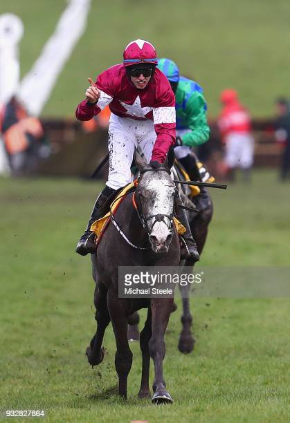 Jack Kennedy celebrates as he rides Farclas to victory in the JCB Triumph Hurdle at the Cheltenham Festival at Cheltenham Racecourse on March 16 2018...