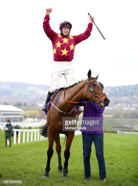 Jack Kennedy celebrates winning the Gold Cup during the WellChild Cheltenham Gold Cup Chase race on Day Four of the Cheltenham Festival 2021 at...