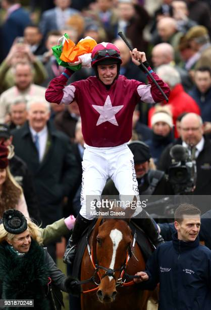 Jack Kennedy ridding Samcro celebrates after winning Ballymore Novices' Hurdle during Cheltenham Festival Ladies Day at Cheltenham Racecourse on...