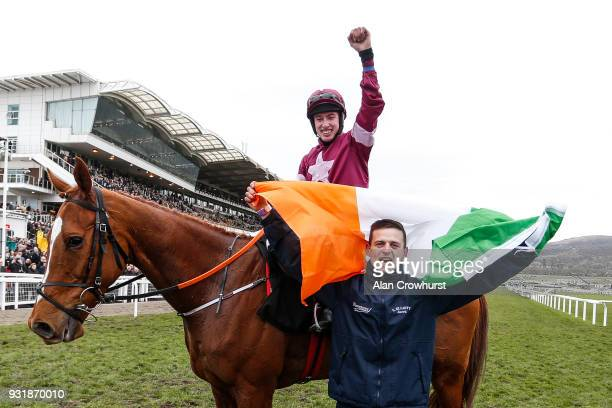 Jack Kennedy riding Samcro wins The Ballymore Novices' Hurdle Race at Cheltenham racecourse on Ladies Day on March 14 2018 in Cheltenham England