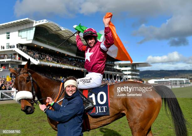 Jack Kennedy riding Shattered Love celebrates victory in the JLT NovicesÕ Chase at Cheltenham Racecourse on March 15 2018 in Cheltenham England