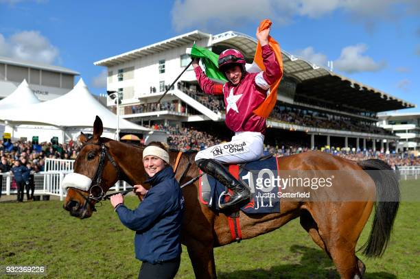 Jack Kennedy riding Shattered Love celebrates victory in the JLT NovicesÕ Chase at Cheltenham Racecourse on March 15, 2018 in Cheltenham, England.