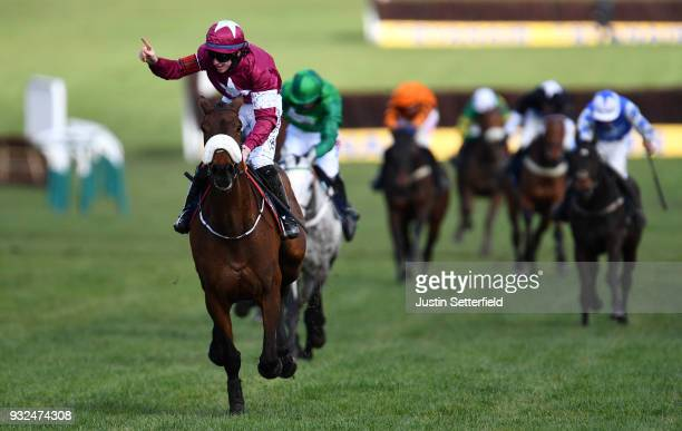 Jack Kennedy riding Shattered Love celebrates victory in the JLT Noviices Chase at Cheltenham Racecourse on March 15 2018 in Cheltenham England