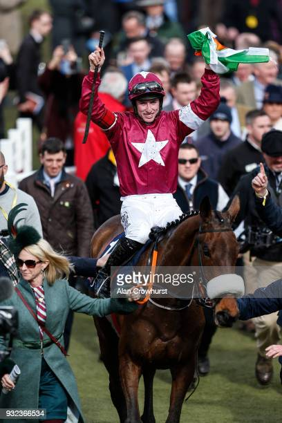 Jack Kennedy riding Shattered Love wins The JLT Novicesâ Steeple Chase at Cheltenham racecourse on St Patrick's Thursday on March 15 2018 in...