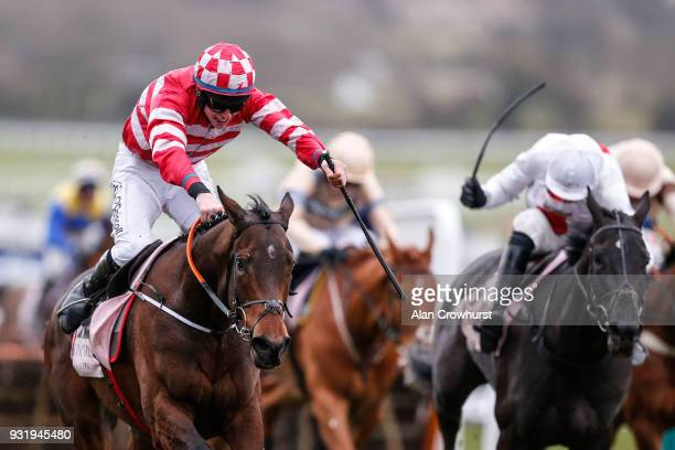 Jack Kennedy riding Veneer Of Charm clear the last to win The Boodles Fred Winter Juvenile Handicap Hurdle Race at Cheltenham racecourse on Ladies...