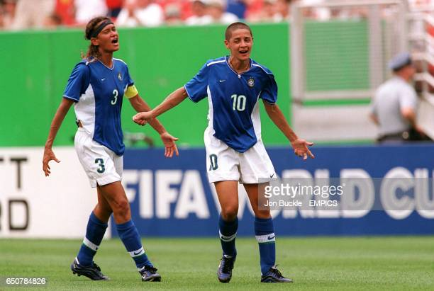 USA WASHINGTON Jack Kent Cooke Stadium Brazilian captain Elane comes to celebrate with an ecstatic Sissi as she is named player of the match