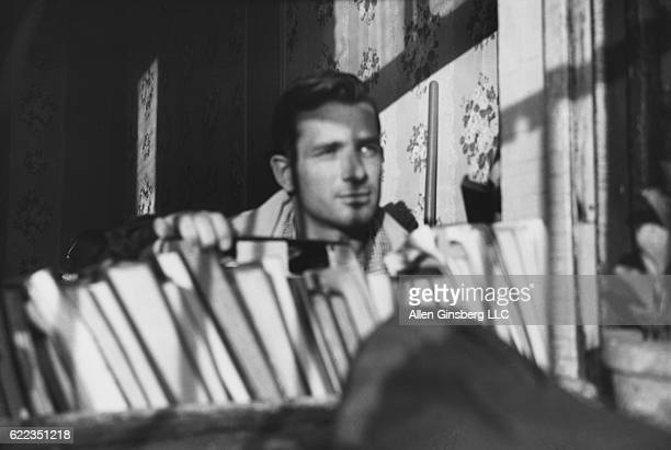 Jack Kerouac looks out the fire escape window of Allen Ginsberg's East Seventh Street apartment in New York City