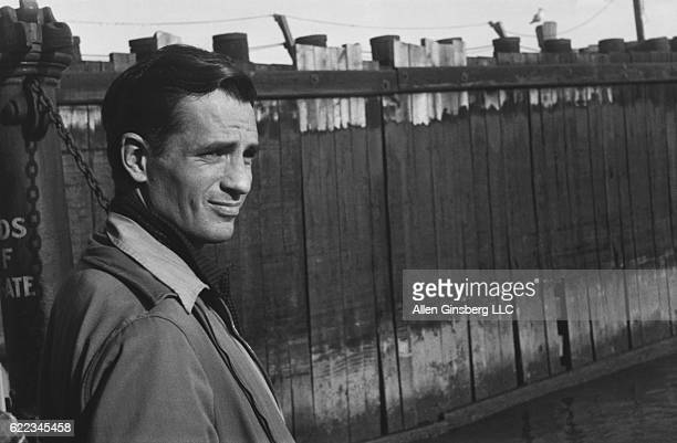 Jack Kerouac waits for a ferry at a dock in Staten Island