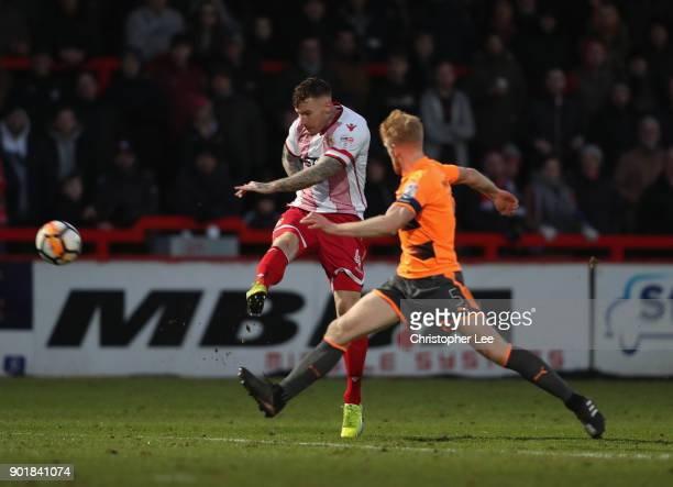 Jack King of Stevenage vollies his shot past Paul McShane of Reading during The Emirates FA Cup Third Round match between Stevenage and Reading at...