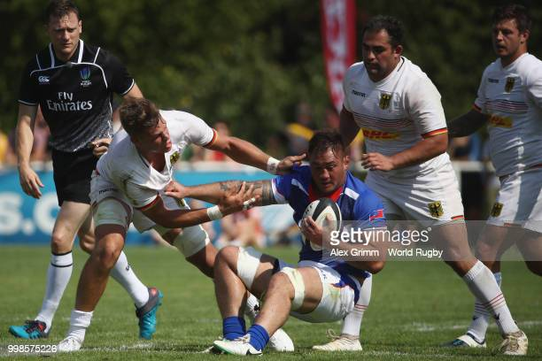 Jack Lam of Samoa is challenged by Sebastian Ferreira of Germany during the Germany v Samoa Rugby World Cup 2019 qualifying match on July 14 2018 in...