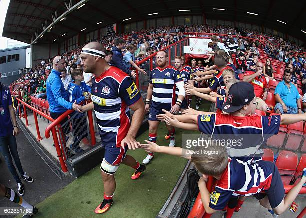 Jack Lam the Bristol captain leads his team onto the pitch after their return to the Premiership during the Aviva Premiership match between Bristol...