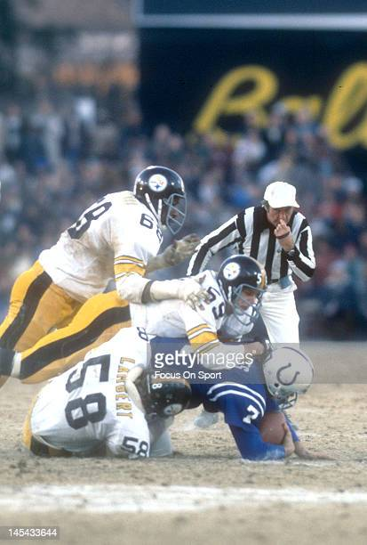 Jack Lambert and Jack Ham of the Pittsburgh Steelers sacks Bert Jones of the Baltimore Colts during the NFL/AFC Conference playoff game at Memorial...