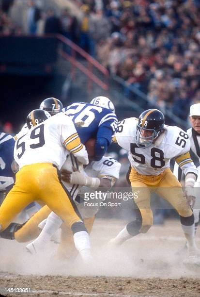 Jack Lambert Jack Ham and Ernie Holmes of the Pittsburgh Steelers tackles Lydell Mitchell of the Baltimore Colts during the NFL/AFC Conference...