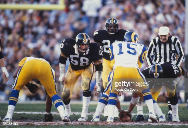 Jack Lambert linebacker for the Pittsburgh Steelers eyes Vince Ferragamo quarterback for the Los Angeles Rams as he calls for the snap during Super...