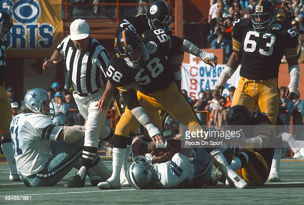 Jack Lambert of the Pittsburgh Steelers tackles Preston Pearson of the Dallas Cowboys during Super Bowl X on January 18 1976 at the Orange Bowl in...