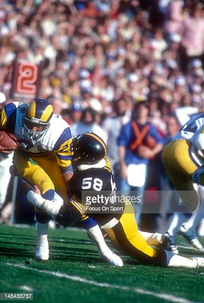 Jack Lambert of the Pittsburgh Steelers tackles Wendell Tyler of the Los Angeles Rams during Super Bowl XIV on January 20 1980 at the Rose Bowl in...
