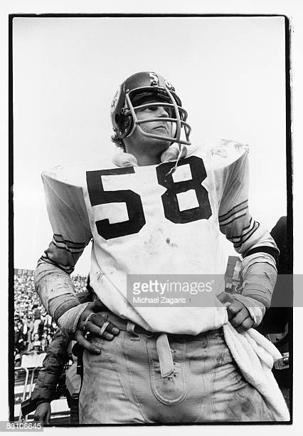 Jack Lambert of the Pittsburgh Steelers watches the action during the 1976 AFC Championship game against the Oakland Raiders at Oakland Alameda...
